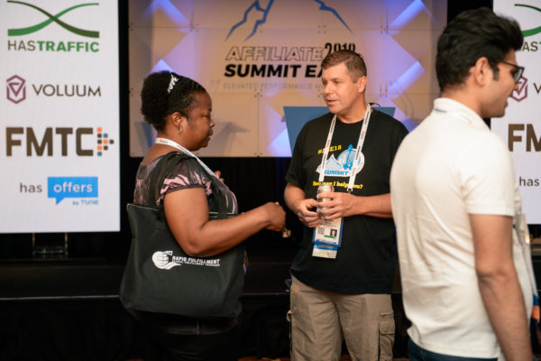 Shawn Collins chats with an attendee after his session