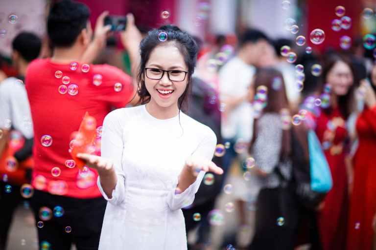 Woman standing amongst bubbles