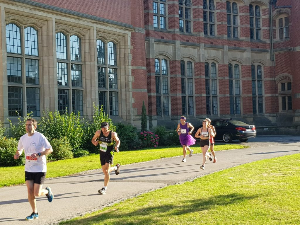 People running past Aston Webb