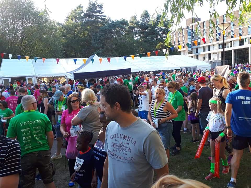 Crowd of people exploring the games village