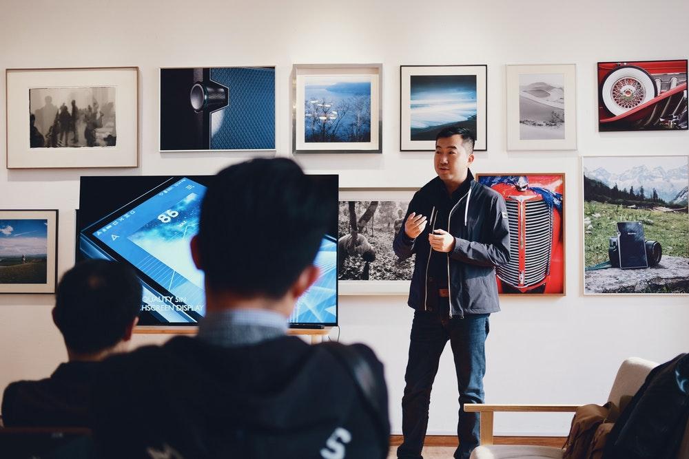 Man presenting art