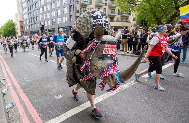 Man dressed as a rhino running a marathon