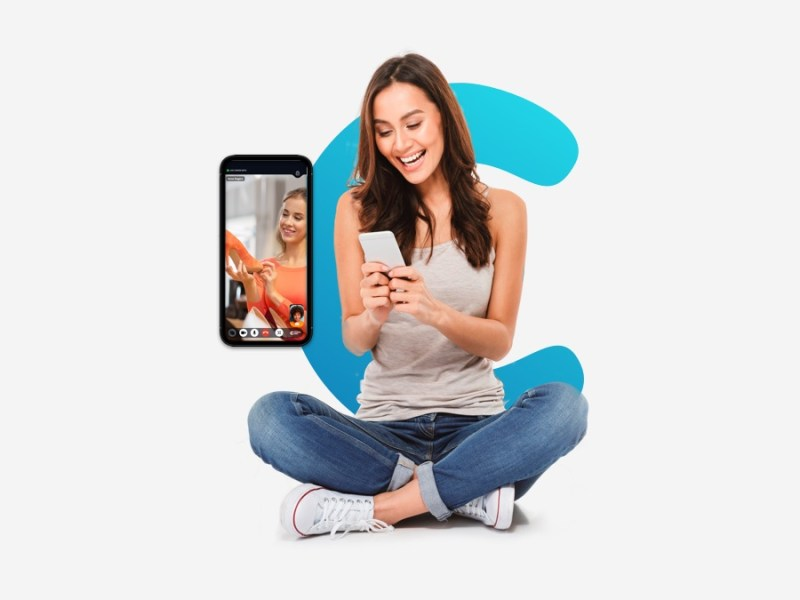 a woman who is expericing customer engagement through video commerce. She is on her phone in a video call with a retailer expert.