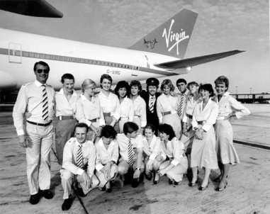 Sir Richard Branson with the cabin crew of Virgin's maiden flight between LGW-EWR on Boeing 747-200 G-VIRG 'Maiden Voyager'.