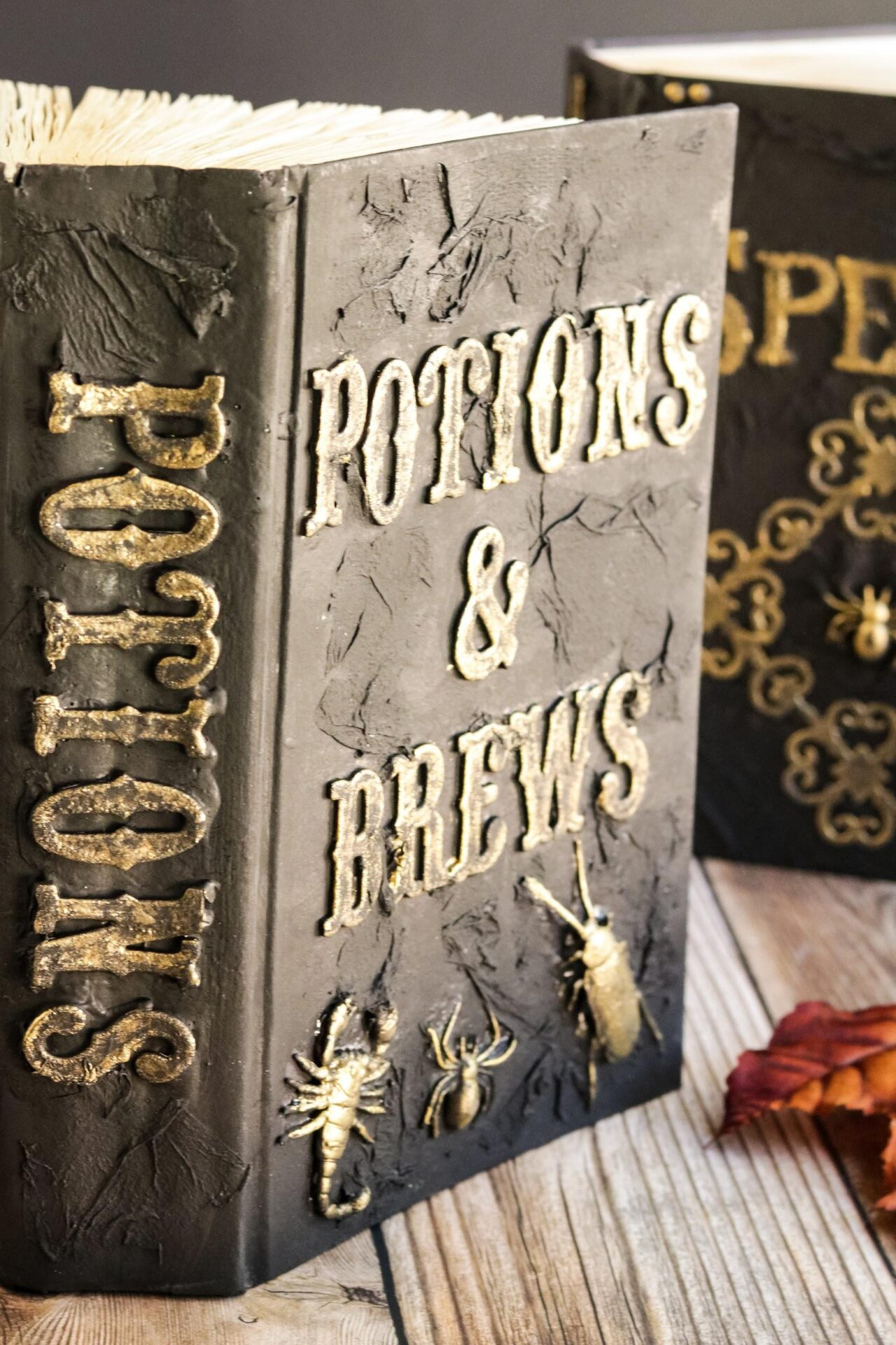 Are you a lover of decorating for Halloween? This DIY Spell Book is a must for your Halloween decorating ideas this year. Check out how easy it is to make