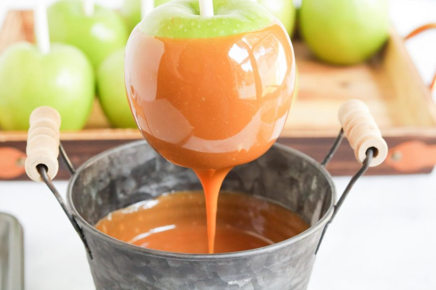 Making homemade caramel apples is super simple and can be easily done with this super simple homemade caramel apple recipe.
