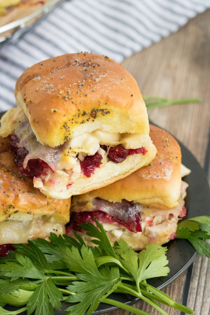 Turkey cranberry sliders are the perfect addiition to your leftover turkey recipes! These are simple to make and taste amazing! With the hawaiian rolls and garlic mustard, you can't beat this Thanksgiving leftover treat!