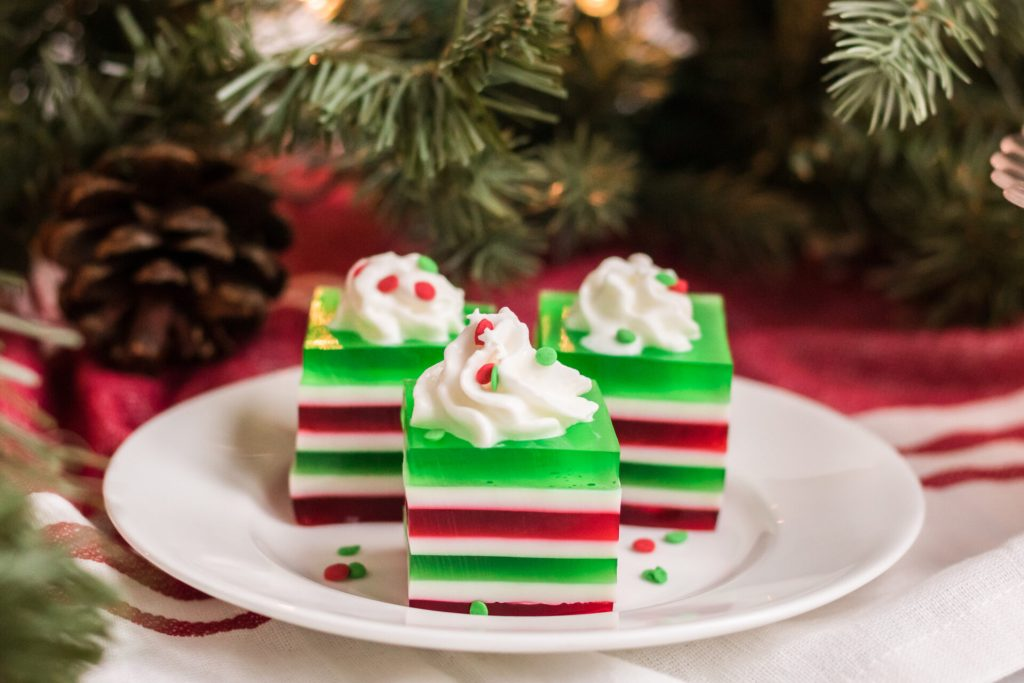 This festive red and green Christmas layered jello is the perfect Christmas finger jello for your next holiday gathering. Kids and adults love eating jello fingers!