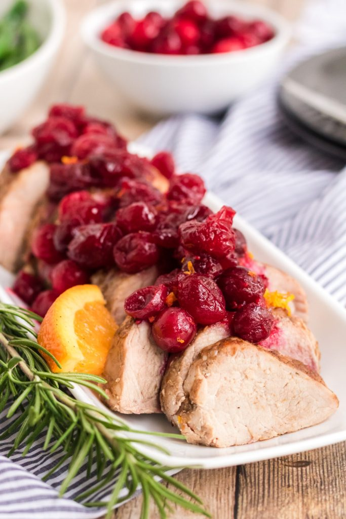 Slow cooker Cranberry Pork Tenderloin is easy to make. The pork tenderloin combined with cranberry and orange offers so much flavor! This will be the star of your holiday dinner table or any time you decide to make it!