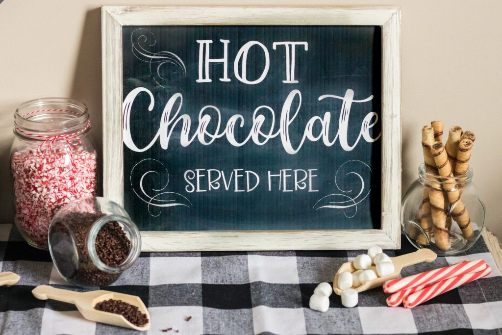hot chocolate served here sign with toppings