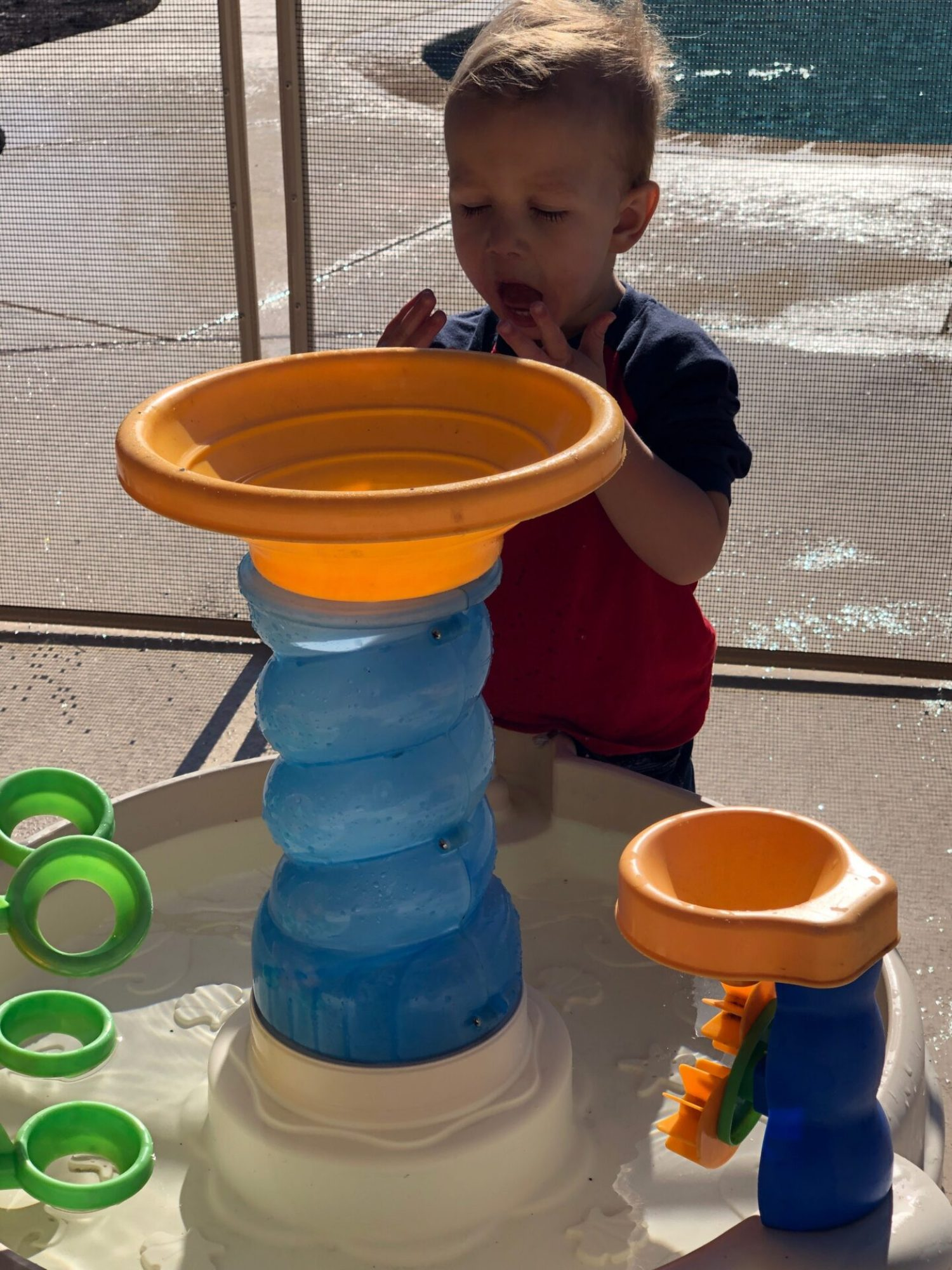 water table with toddler boy