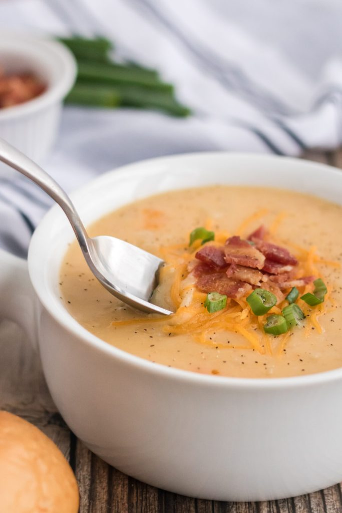 spoon in Instant Pot Potato Soup in white bowl
