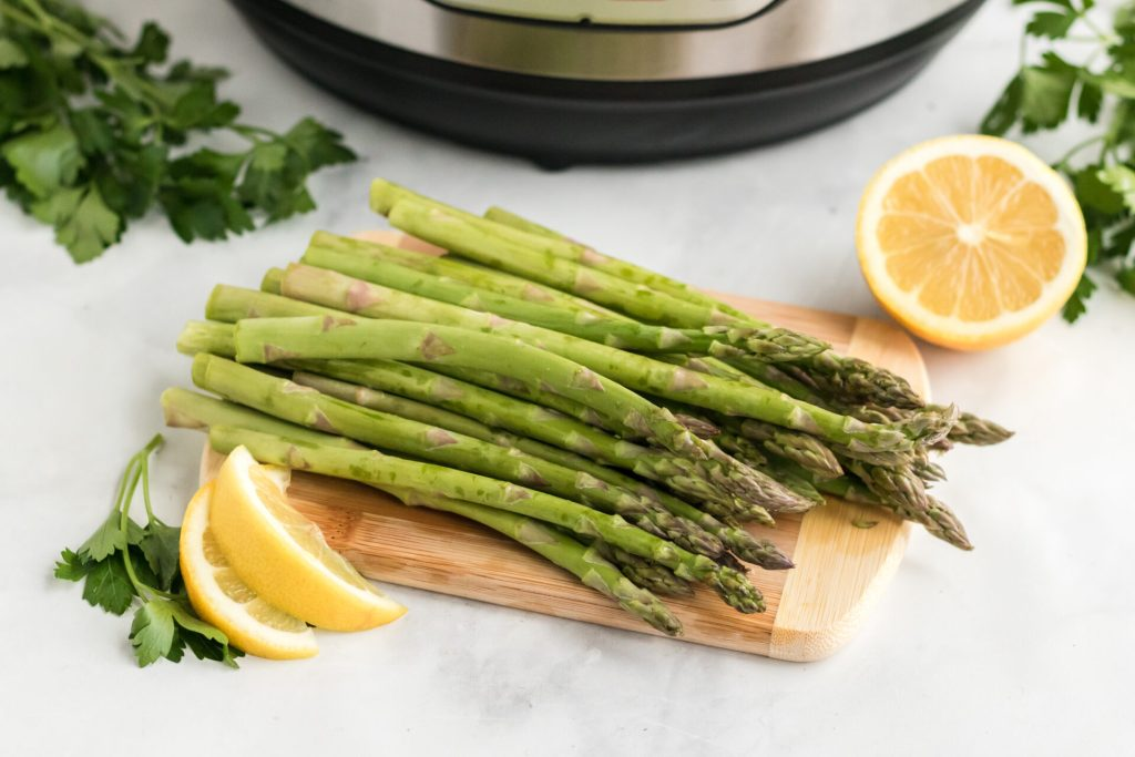 asparagus on cutting board with lemon