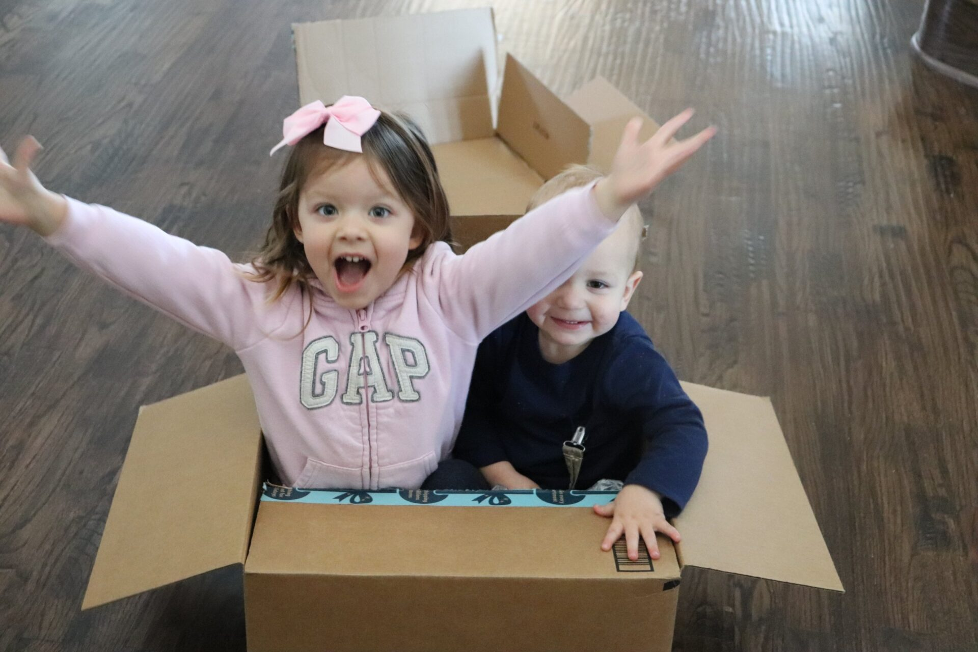two kinds in a box happy because they know what positive affirmations for toddlers are and feel good about themselves
