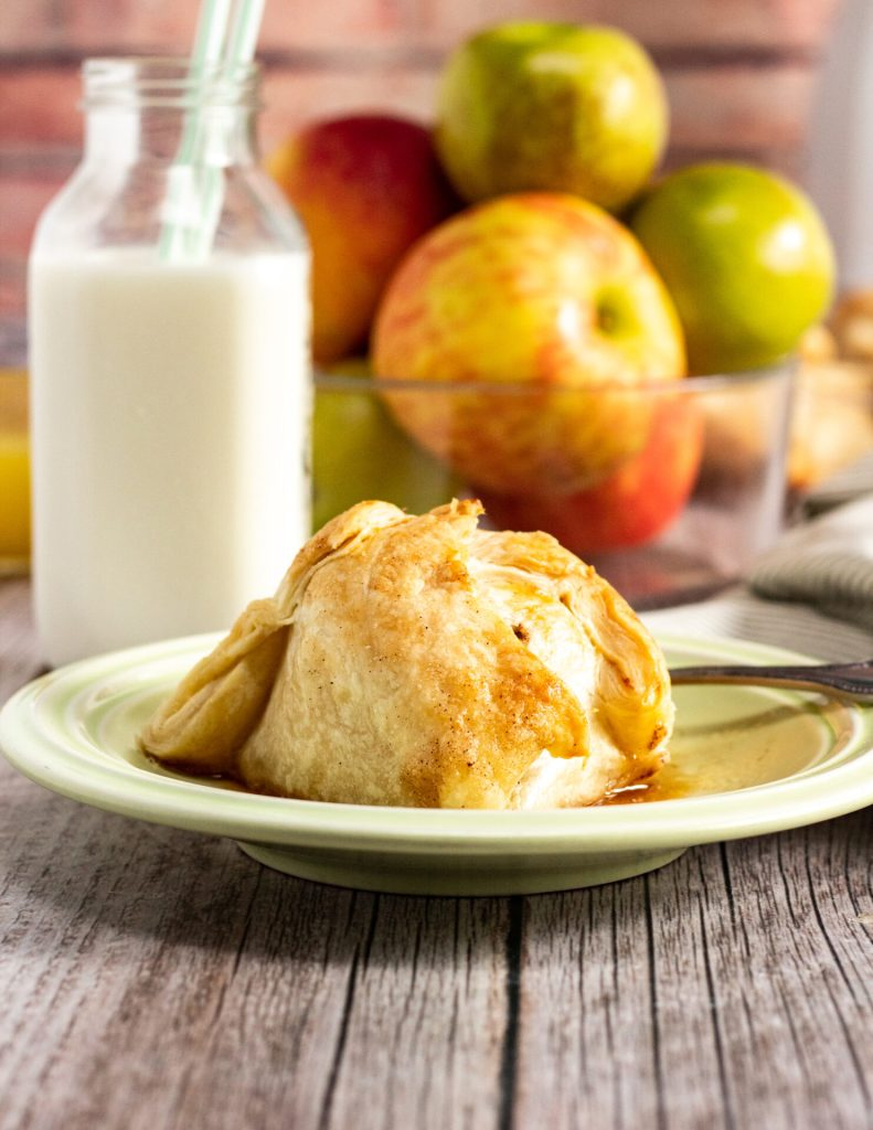 apple dumpling with glass of milk