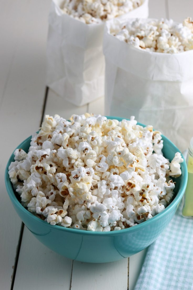 Popcorn cooked in Instant pot in teal bowl and in bags