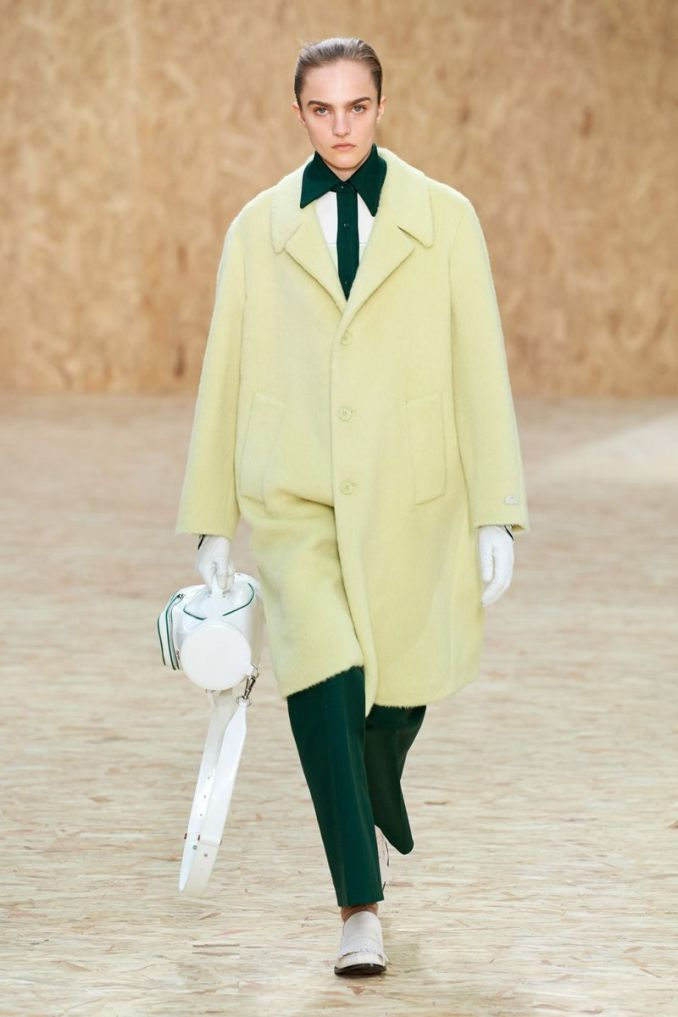 The most fashionable color - a bright yellow-green coat from the Lacoste collection