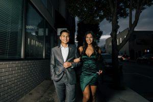 man-in-gray-suit-standing-beside-woman-in-green-dress-3664688