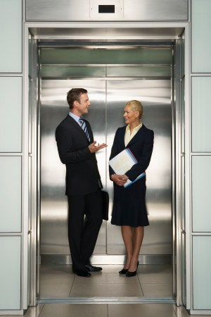 Colleagues conversing in an elevator