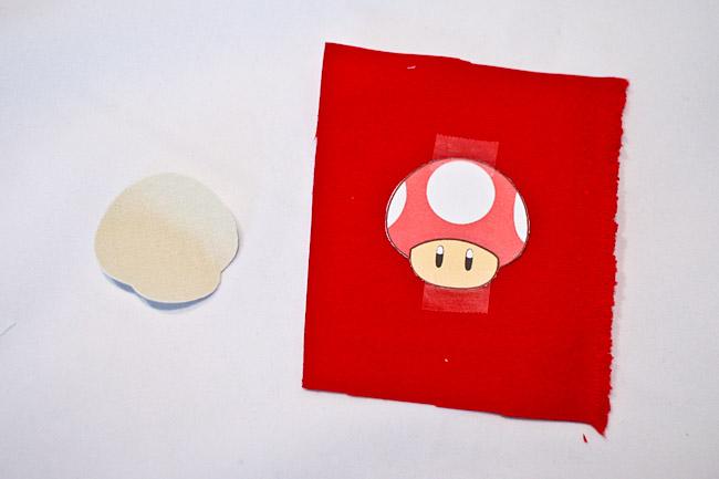 Tape mushroom image to red fabric