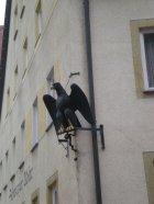 "The writing on the building says ""Schwarzer Adler"", Black Eagle"