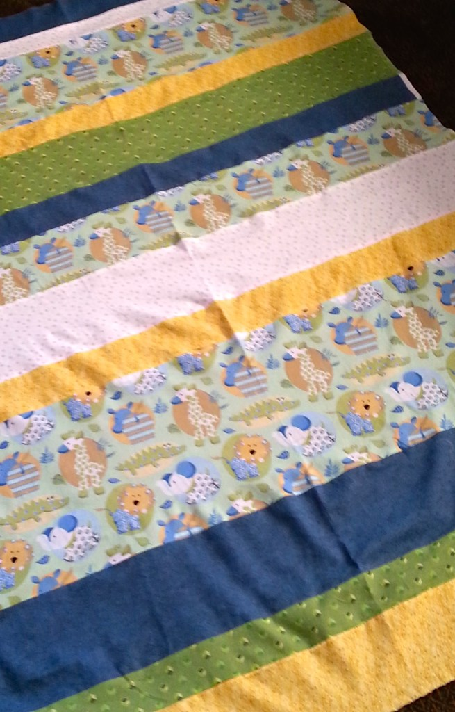 Top of a baby quilt all ready for batting and backing.