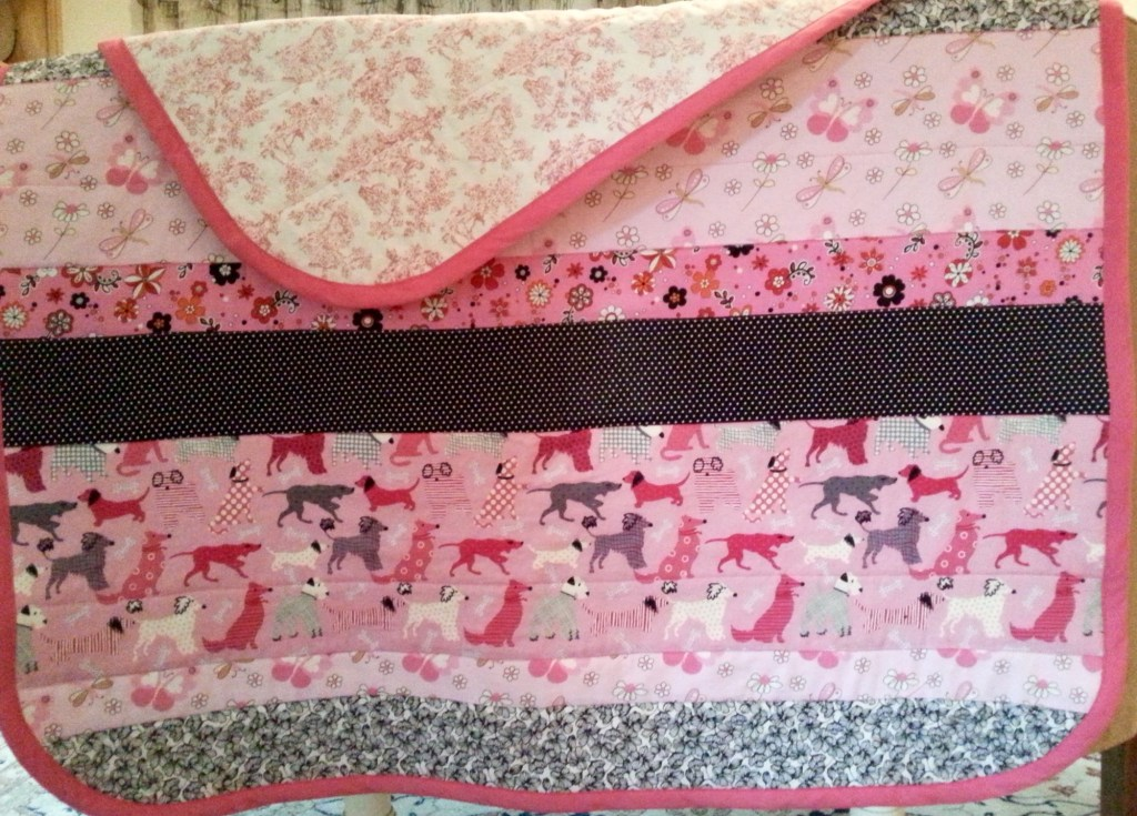 Quilt #2 - Totally love the pink black combo. Actually, the first fabrics selected were the pink flowers, and black/white polka dots. But my true love is the toile on back.  I would have toile in every room in my house if I could get away with it.