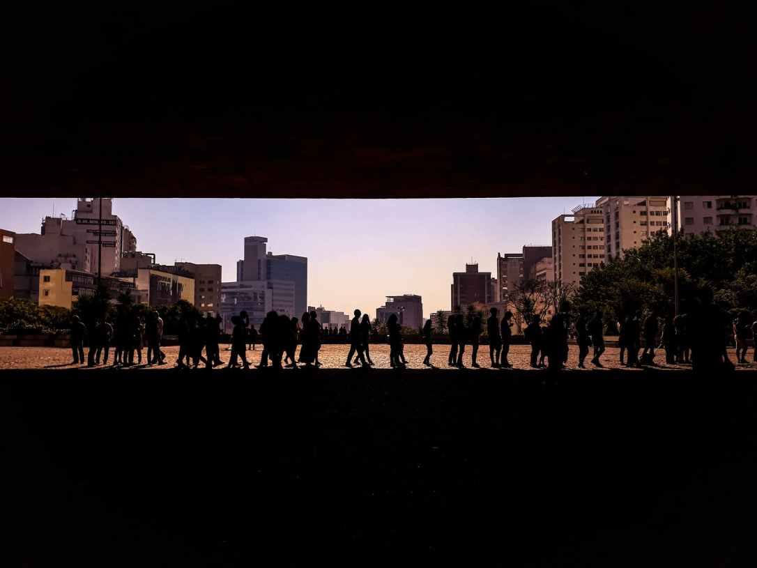 silhouette of people in queue