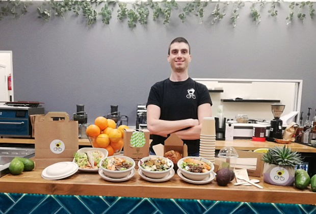 Dr Daniele D'Agostino, research fellow at the Food Innovation Centre, with sustainable packaging at the Avocafe in Lenton, Nottingham.-c63c3752