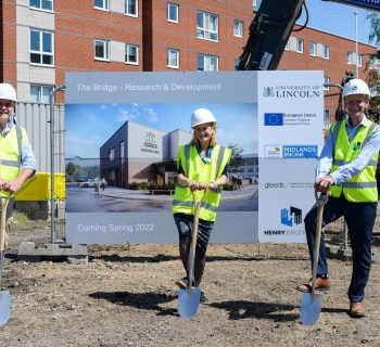 UnioLincoln The Bridge ground breaking  L-R Professor Ian Scowen and Professor Libby John of the University of Lincoln with Ian Taylor, Managing Director of Henry Brothers Midlands-4e094bcf