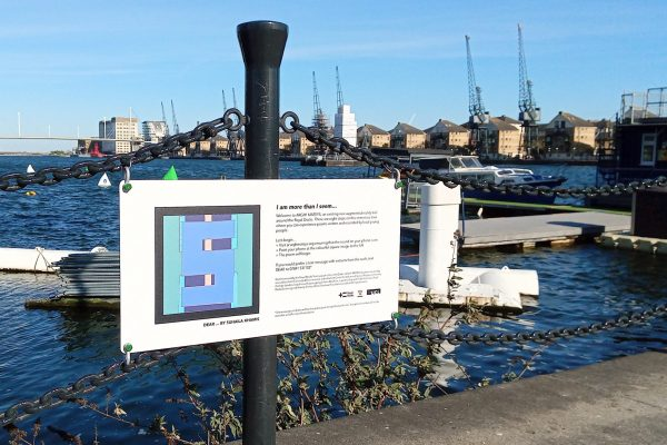 Photograph showing the installed sign with an AR marker designed by Suhaila Khamis for her poem titled Dear dot dot dot