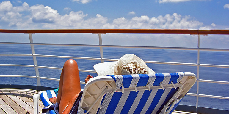 women-laying-on-chair-on-cruise-deck-770