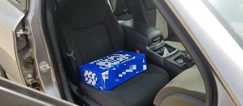Driver Cited For Using 30-Can Beer Pack As Toddler's Booster Seat
