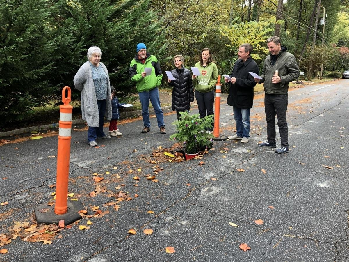 Neighbors Fed Up With Growing Pothole Fill It With Christmas Tree