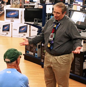 Connecting Point Computer Centers Sales Specialist helps a customer