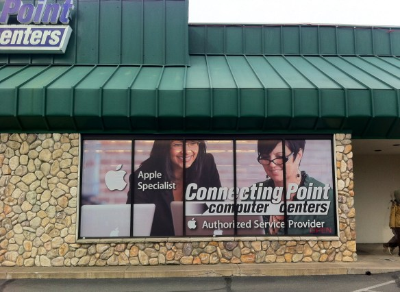 Large-format Apple-themed window graphics Connecting Point Medford Oregon