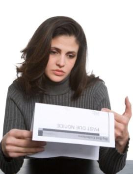 Woman looking at past due notice after holiday spending spree.