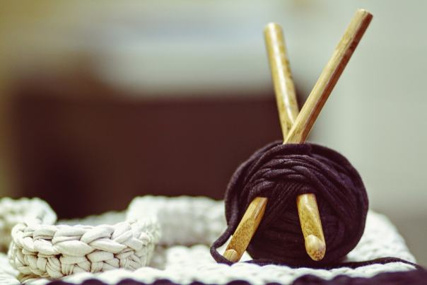 A roll of yarn wrapped around crochet hooks