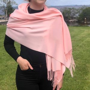Cashmere Blend Wrap by Connemara Weavers in Salmon Wrapped around shoulder