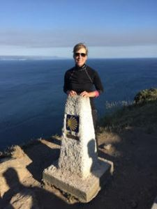 Deborah at the Atlantic, the journey's end point. The shell motif is used on markers along the Camino.
