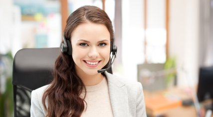 woman on headset smiling
