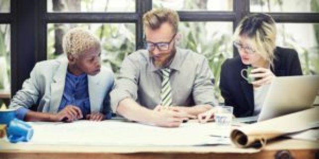 3 people around desk