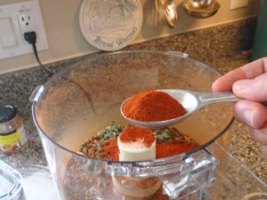 Adding powdered spices: Paprika, chili powder, cocoa and cinnamon