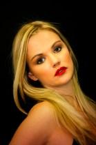 207-img_7761-women-long-blonde-hair-black-background-1-vignette
