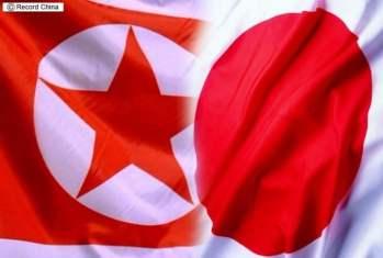 Banderas de Corea del Norte y de Japón