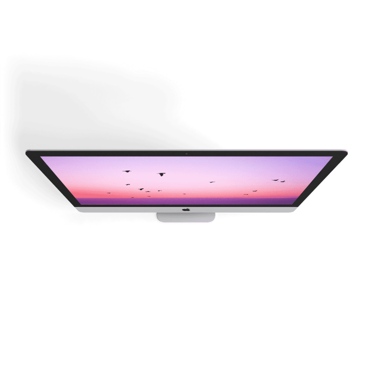 tilted apple imac with purple wallpaper