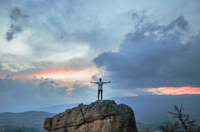 unsplash man on mountain