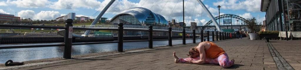 Conrad doing yoga on the quayside