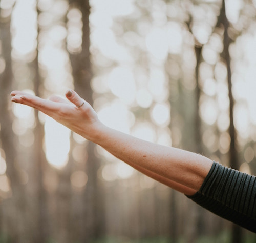 Woman reaching toward sky   conscious content alchemy