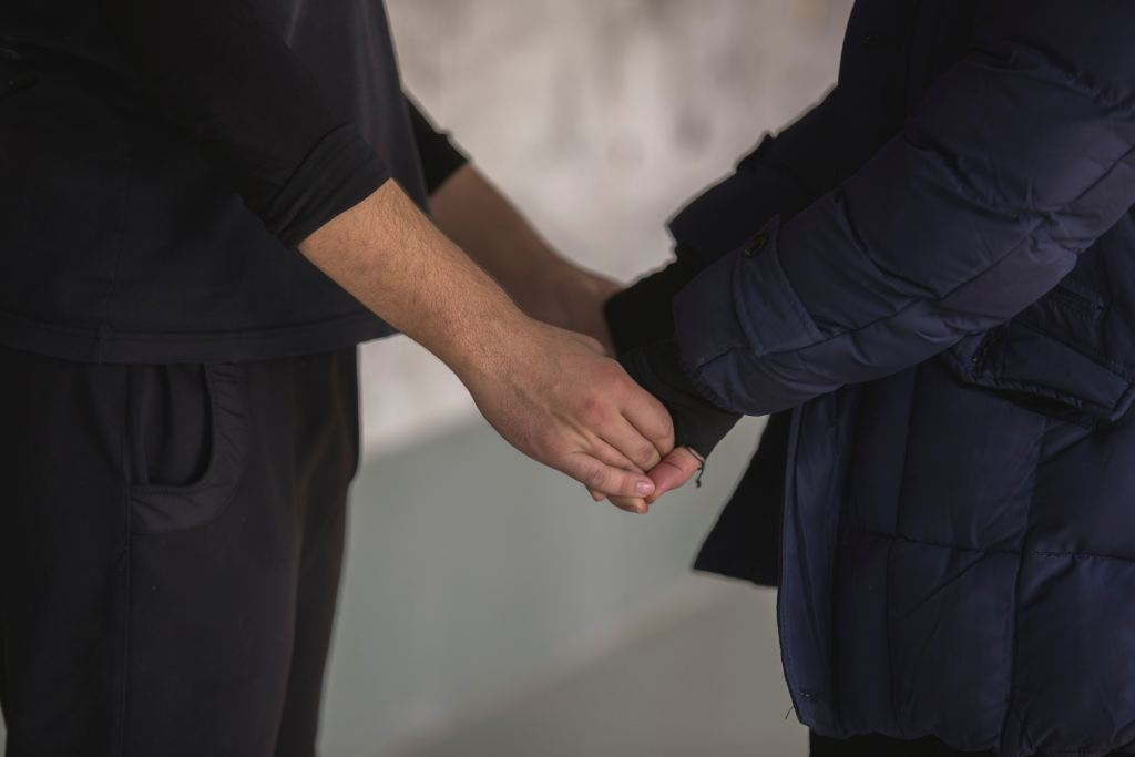 How to be a social activist at work | man relating with another by holding hands